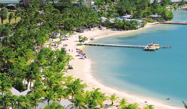 St James's Club Antigua aerial shot of beach sand sea palm trees jetty boats