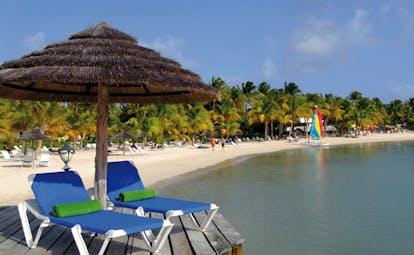 St James's Club Antigua beach terrace sun loungers umbrella