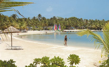 St James's Club Antigua beach woman walking on the sand
