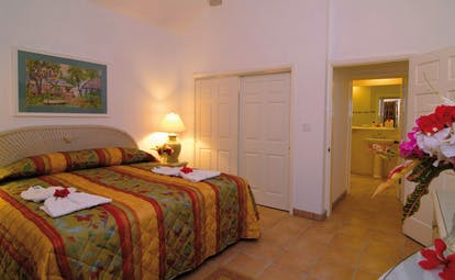 St James's Club Antigua bedroom bed flower arrangement modern décor