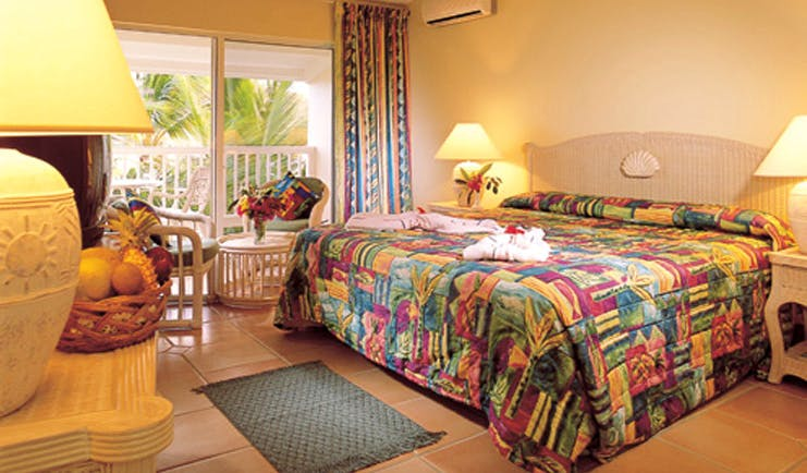 St James's Club Antigua guestroom bed chairs colourful décor