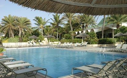 St James's Club Antigua main pool sun loungers beach in background