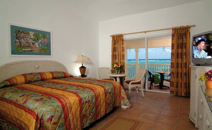 St James's Club Antigua premium bedroom bed access to private terrace overlooking sea