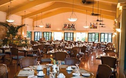 St James's Club Antigua rainbow restaurant interior dining tables modern décor