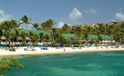 St James's Club Antigua sandy beach white sand sun loungers palm trees