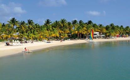 St James's Club Antigua sea and beach sun loungers boats palm trees