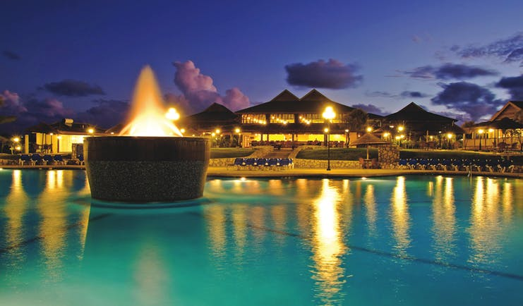 Verandah Resort and Spa Antigua pool by night lit up water feature