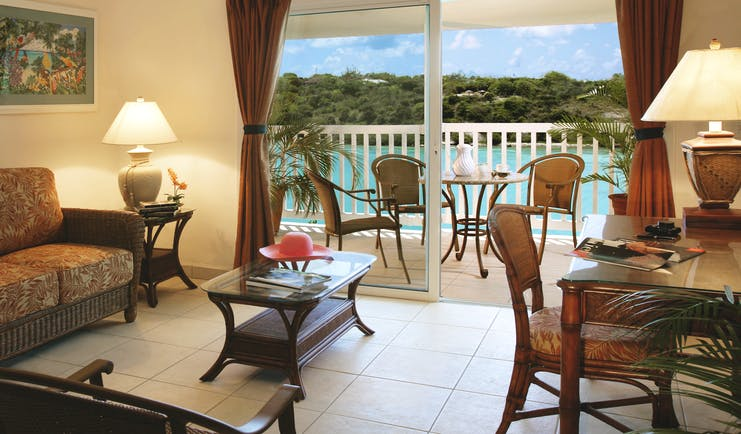 Verandah Resort and Spa Antigua suite lounge area with indoor seating area and terrace overlooking the sea