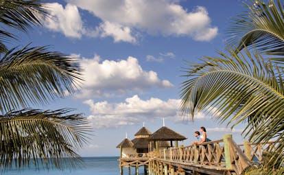 Kamalame Cay Bahamas ocean palm trees bridge to pagoda in the sea