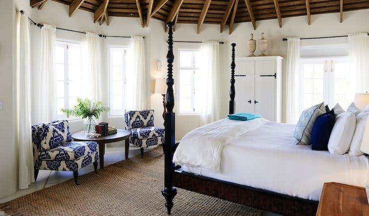 Kamalame Cay Bahamas villa bedroom  with armchairs and wardrobes