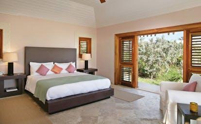 Pink Sands Bahamas bedroom minimal modern decor armchair doors to garden