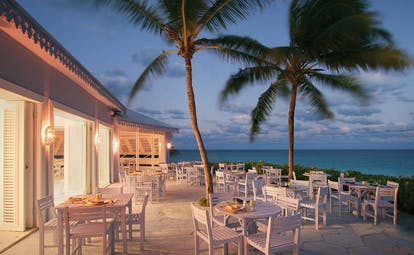 Pink Sands Bahamas Blue Bar outdoor dining area palm trees ocean view
