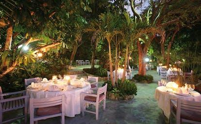 Pink Sands Bahamas garden terrace outdoor dining area in garden at night