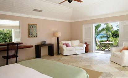 Pink Sands Bahamas ocean view cottage bedroom sofa armchair ocean view and garden terrace