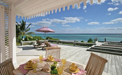 Pink Sands Bahamas outdoor deck dining covered and open deck sun lounger ocean view