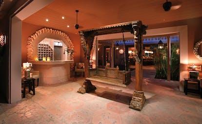 Pink Sands Bahamas reception desk traditional Asian sculptures