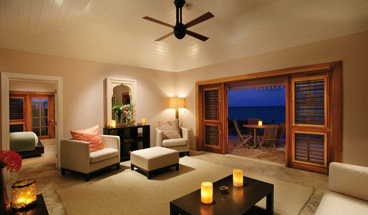 Pink Sands Bahamas suite lounge large room with sofas armchairs and deck access