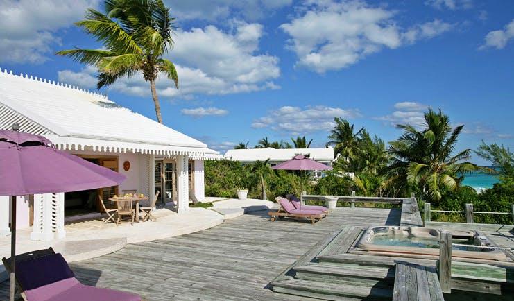 Pink Sands Bahamas villa deck white bungalow hot tub sun loungers ocean view