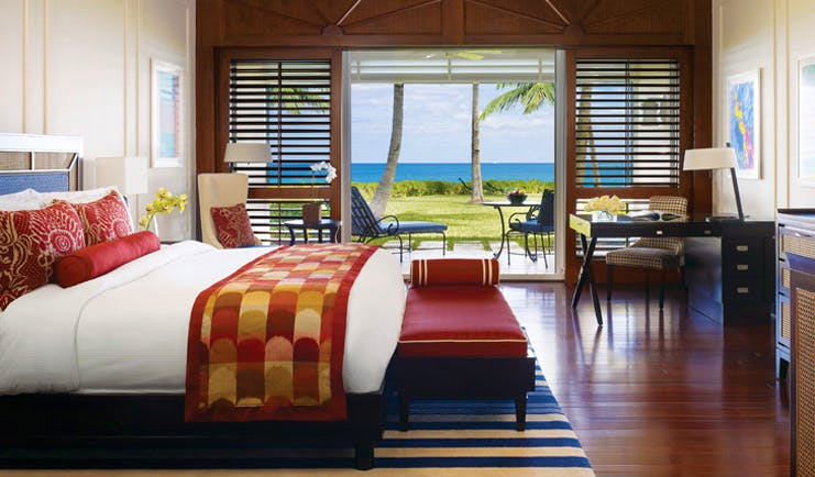 Four Seasons Ocean Club Bahamas beach front bedroom ottoman armchair writing desk patio with seating area