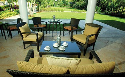 Four Seasons Ocean Club Bahamas boardroom patio seating area with coffee and gardens
