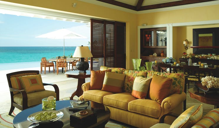 Four Seasons Ocean Club Bahamas villa lounge sofa armchairs dining area and outdoor seating area