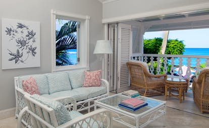 Ocean front suite living room with terrace area looking over sea and sofas inside