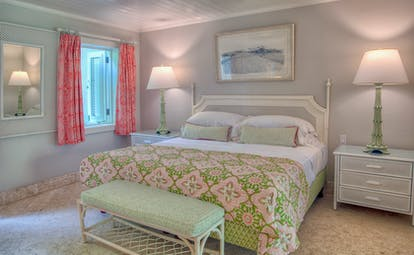Ocean view bedroom with double bed and window with view over ocean