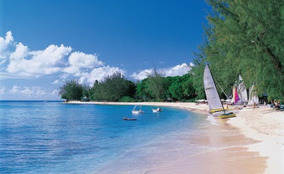 Coral Reef Club Barbados beach and boats on the sand small boats on the water