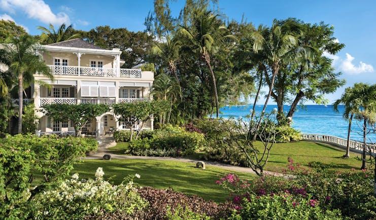 Coral Reef Club Barbados gardens and building overlooking the ocean
