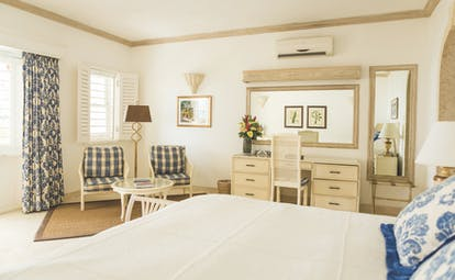 Coral Reef Club Barbados bedroom with living area and dressing table