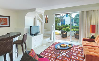 Crystal Cove Barbados downstairs lounge area with private outside seating area through doors