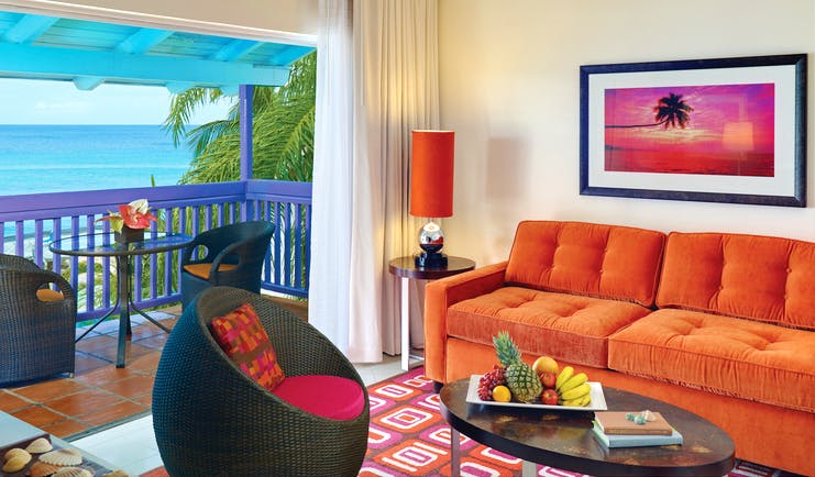 Crystal Cove Barbados living room with balcony and ocean views