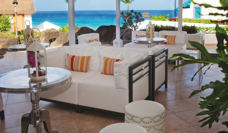 Crystal Cove Barbados lounge area outside covered seating ocean views