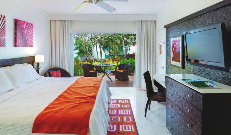 Crystal Cove Barbados standard room bedroom with outdoor seating area