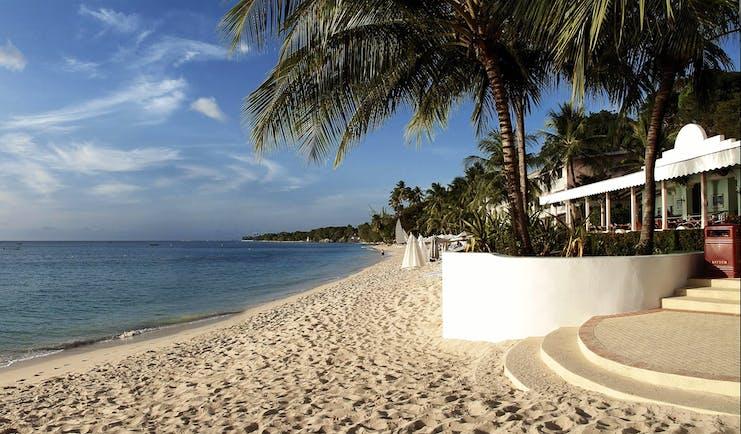 Fairmont Royal Pavilion Barbados beach entrance palm trees sandy beach