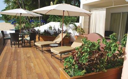 Fairmont Royal Pavilion Barbados beach front terrace sun loungers and umbrellas views of the ocean
