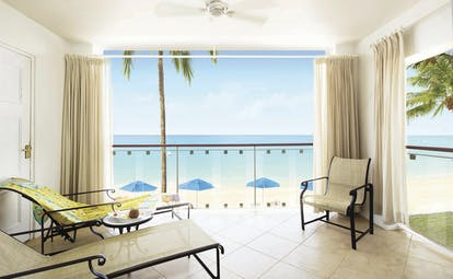 Fairmont Royal Pavilion Barbados lounge with views onto the beach and the ocean