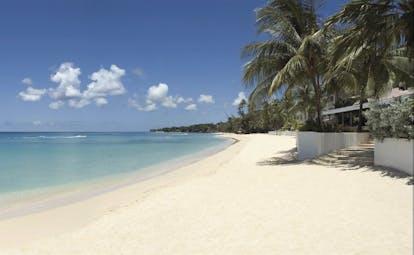 Fairmont Royal Pavilion Barbados sandy beach blue skies and palm trees