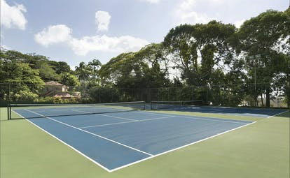 Fairmont Royal Pavilion Barbados tennis court surrounded by trees