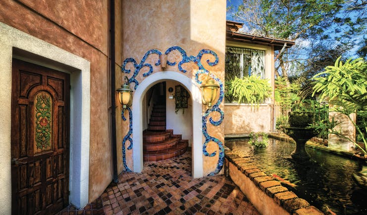 Little Arches Barbados entrance ornate doorway entrance pond and water feature