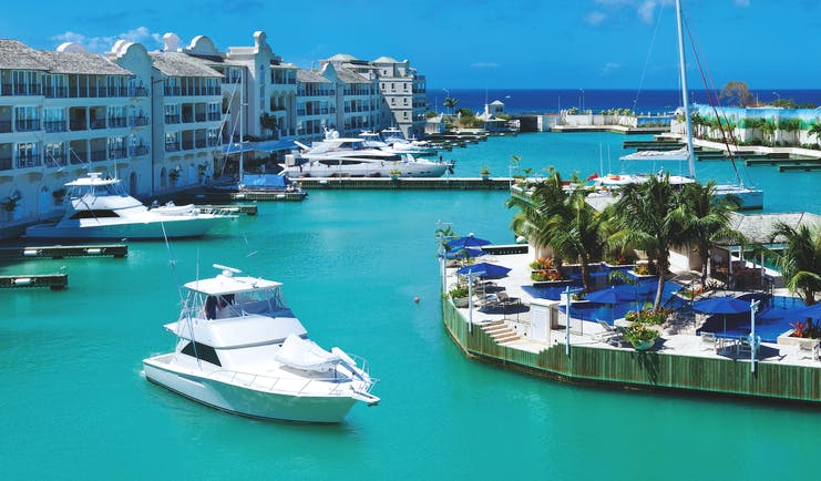 Port Ferdinand Barbados island marina building exterior and boats in harbour