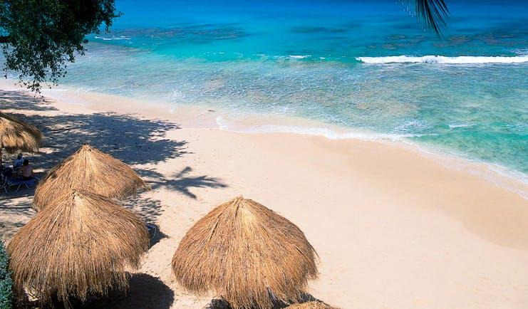 Tamarind Barbados aerial shot of beach cabanas white sand