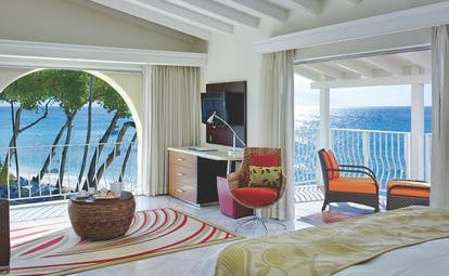 Tamarind Barbados ocean view junior suite bed and lounge area with balcony and terrace overlooking the ocean