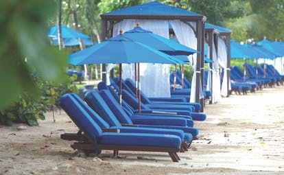 The House Barbados beach sun loungers and umbrellas