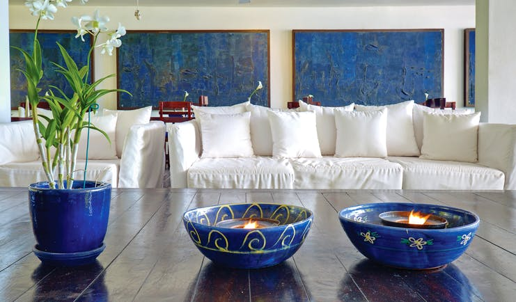 The House Barbados lobby white sofas coffee tables with plants and blue bowls