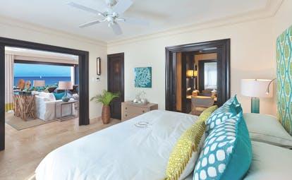 Sandpiper Barbados  beach suite bedroom with adjoining lounge area views of the ocean