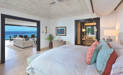 Sandpiper Barbados Curlew Suite bedroom leading to lounge area overlooking the beach