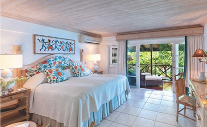 Sandpiper Barbados garden room bedroom leading to terrace with sun loungers