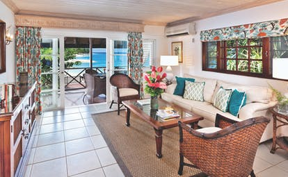 Sandpiper Barbados one bedroom suite lounge leading to terrace seating area with beach views