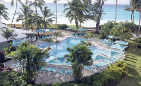Turtle Beach Barbados pool palm trees overlooking the ocean